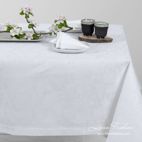 White linen tablecloth in flowers pattern