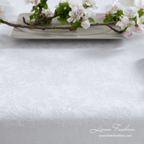 Optical white linen / cotton tablecloth decorated with intricate flower motif ornaments