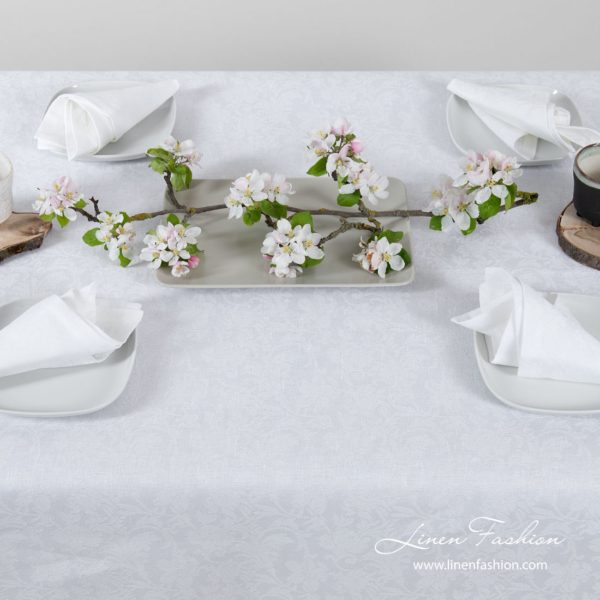 White linen tablecloth with flower ornaments