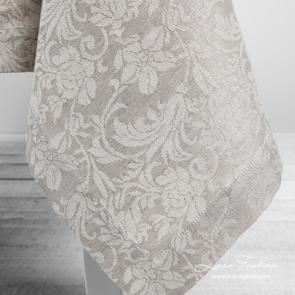 Grey linen tablecloth with flower ornaments, folded border