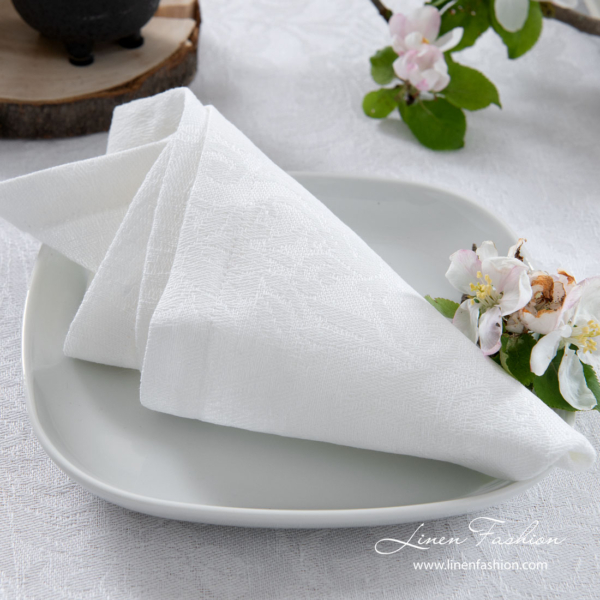 White linen napkin with flower ornaments
