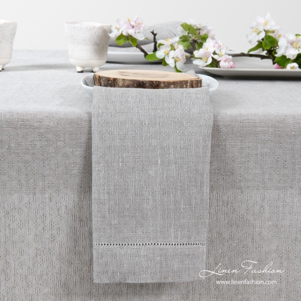 Light grey 100% linen napkin in a slight open-weave pattern, and with a row of hemstitch along all edges