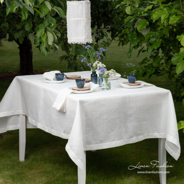 White patterned linen tablecloth with hemstitch