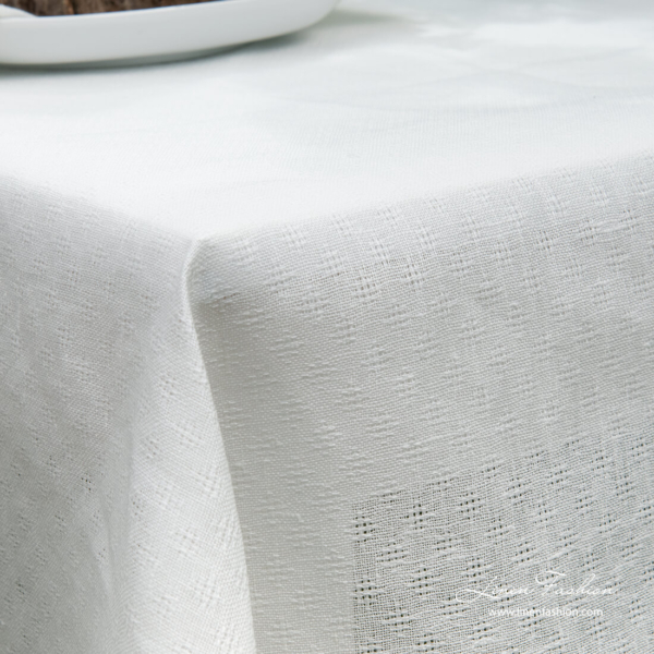 White linen cotton tablecloth with open weave pattern