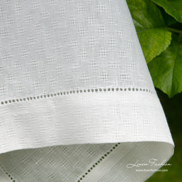 4cm border with hemstitch on white patterned linen tablecloth