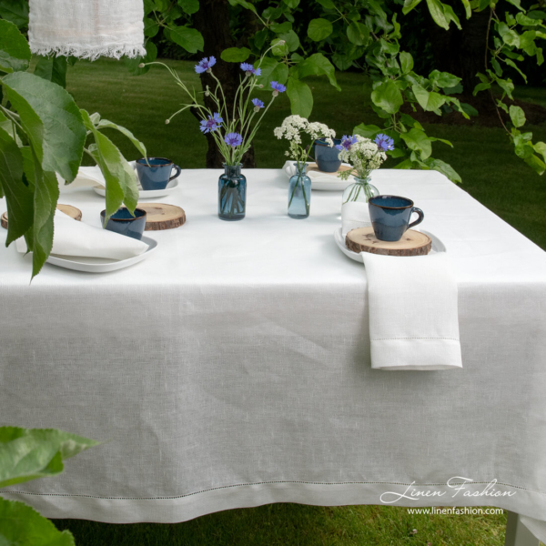 White linen tablecloth with open weave pattern and hemstitch