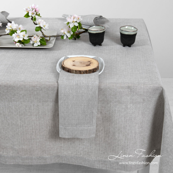 Light grey pure linen tablecloth in a small openwork pattern