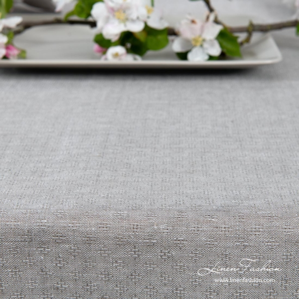 Light grey patterned linen tablecloth with hemstitch