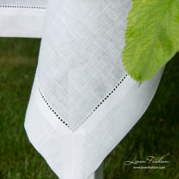4 cm folded border of hemstitched linen tablecloth