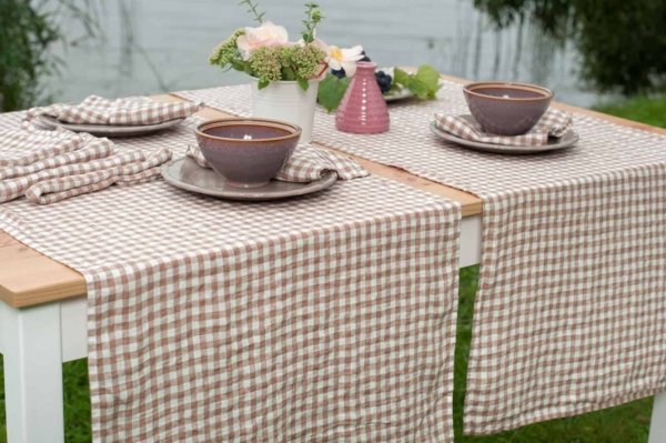 Washed linen table runner in brownish checks 1