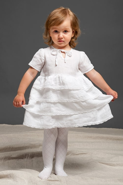 White linen girls' ruffle dress with lace and a bow 1
