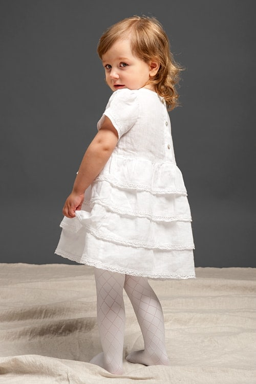 White linen girls' ruffle dress with lace and a bow 2