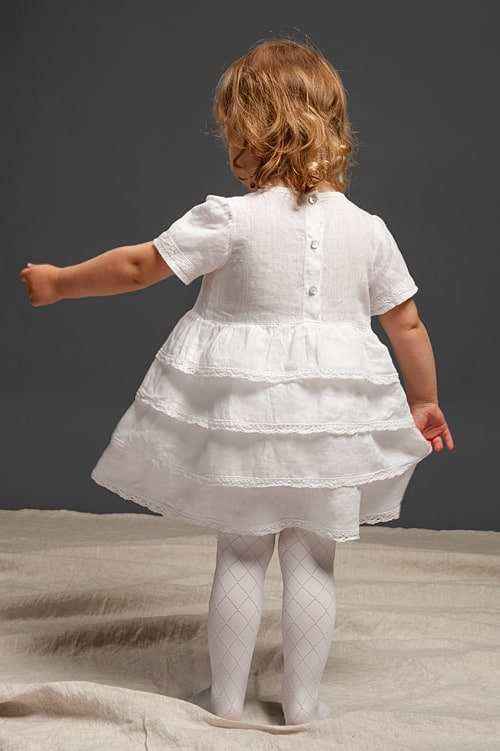 White linen girls' ruffle dress with lace and a bow 3