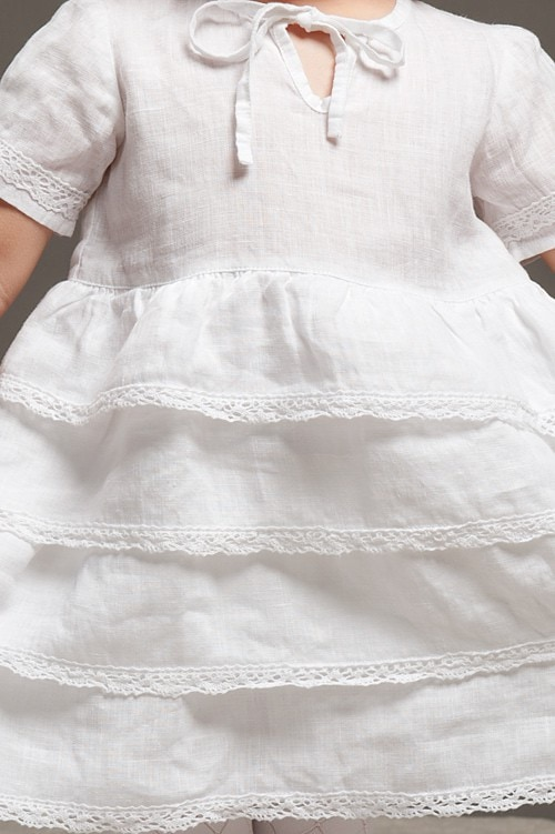 White linen girls' ruffle dress with lace and a bow 4
