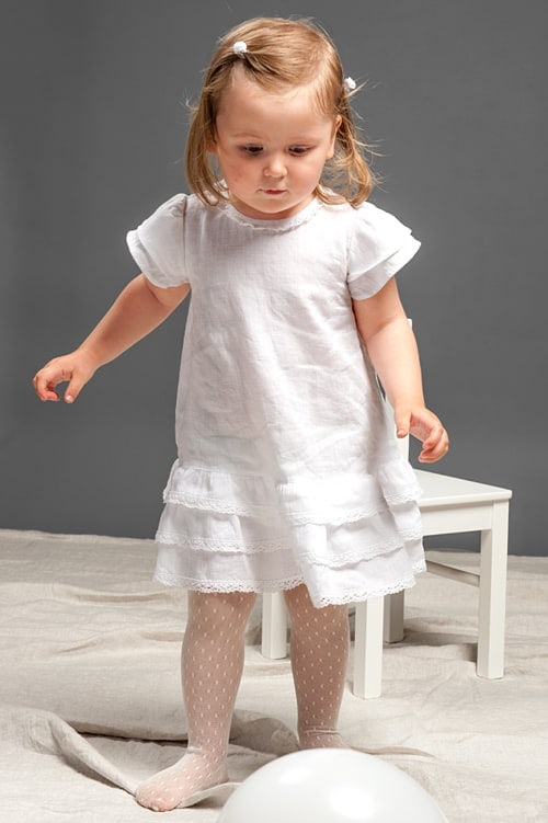 White linen girls' dress with ruffles and lace 1