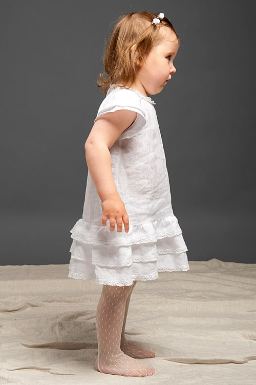 White linen girls' dress with ruffles and lace 2
