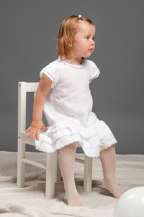 White linen girls' dress with ruffles and lace 4