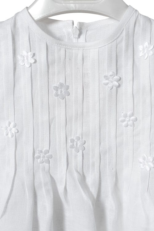 White linen girl's dress with pleats and flowers 2