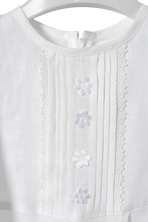 White linen girl's dress with a decorative pocket 2