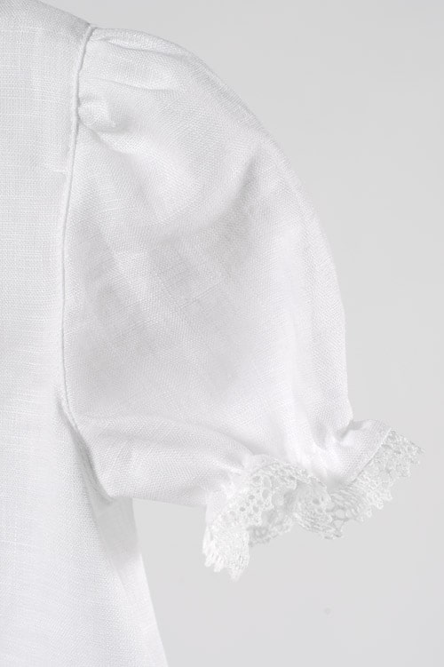 White linen girl's dress with a decorative pocket 3