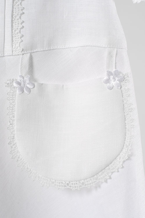White linen girl's dress with a decorative pocket 4