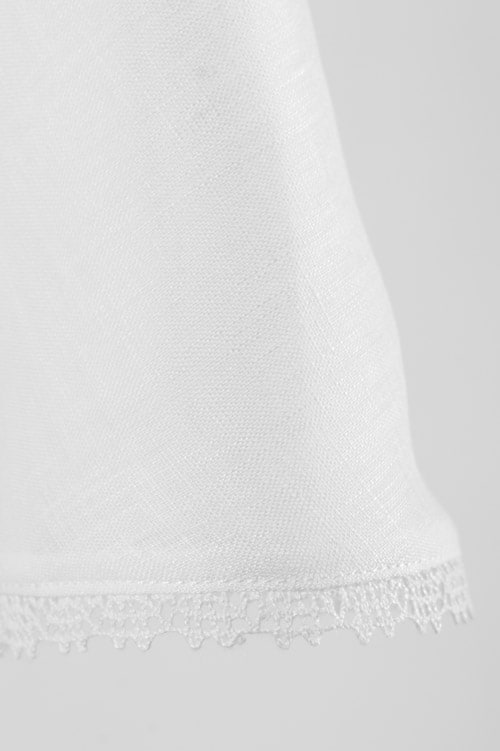 White linen girl's dress with a decorative pocket 5