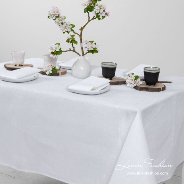 White patterned linen tablecloth, simply hemmed