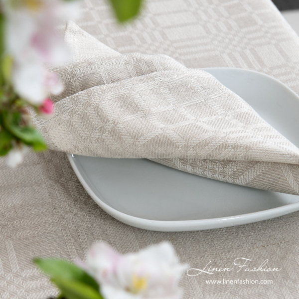 Playfully patterned napkin made from medium weight grey and white linen / cotton fabric
