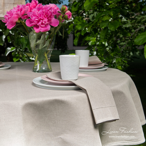 Close view of dark grey round (oval) linen tablecloth with hemstitch