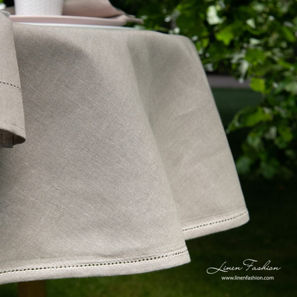 Side view of linen blend dark grey round (oval) tablecloth with hemstitch