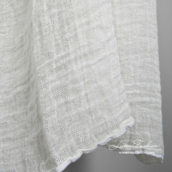 Off white transparent linen fabric with azure diamonds, washed 2