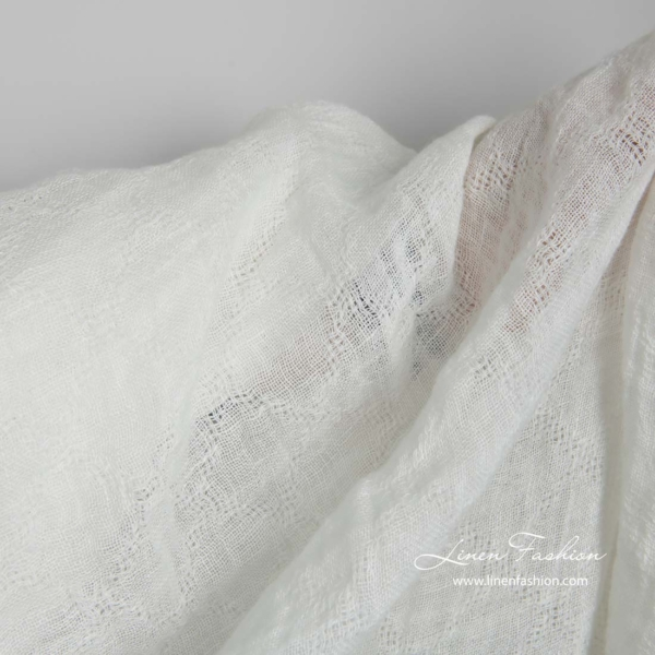 Off white transparent linen fabric with azure diamonds, washed 4