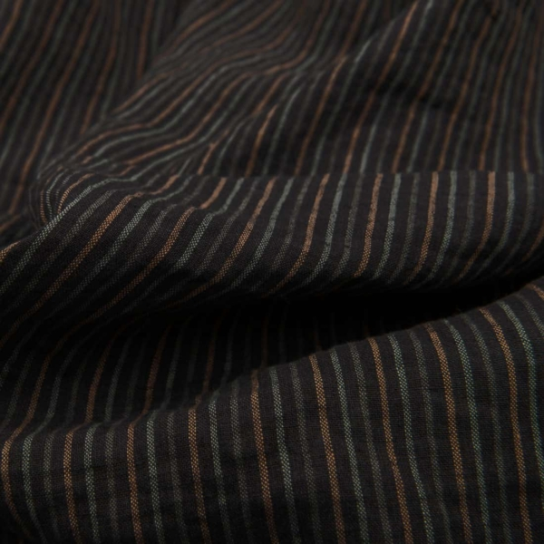 Dark grey linen fabric in pale green striped, washed 1