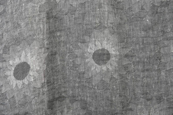 Grey washed linen fabric in a flower pattern 1
