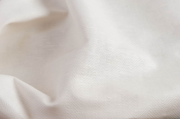 Off-white linen blend fabric in a herringbone pattern 1