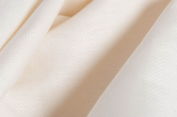 Off-white linen blend fabric in a herringbone pattern 3