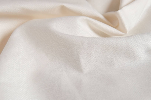 Off-white linen blend fabric in a herringbone pattern 4