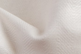 Off-white linen blend fabric in a herringbone pattern 2