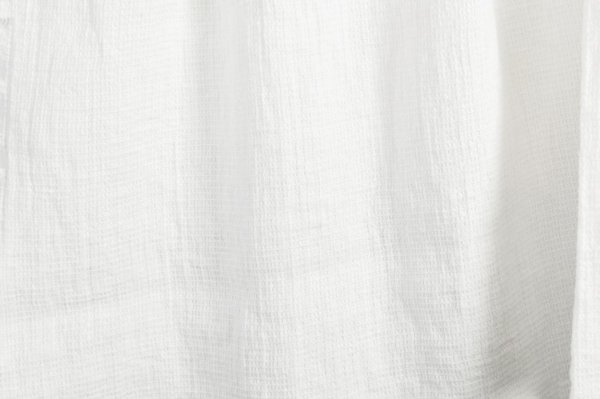 Off-white washed linen fabric in a small check pattern 1