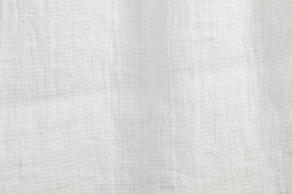 Off-white washed linen fabric in a small check pattern 2