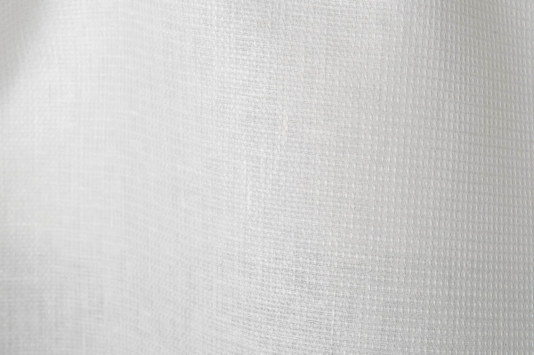 Bright white linen fabric in a small check pattern 1