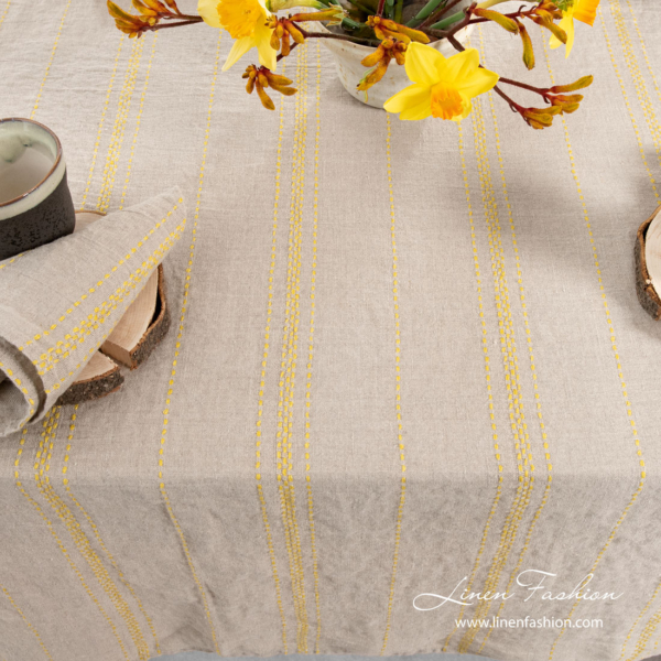 Natural linen tablecloth with yellow stripes, washed