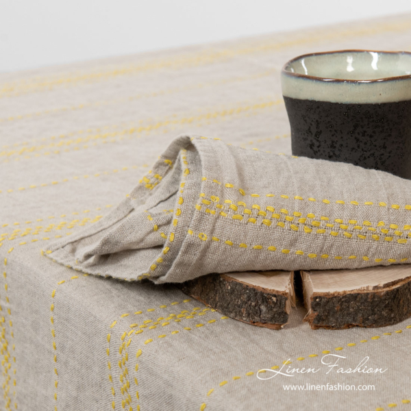 Gray linen napkin with yellow stripes