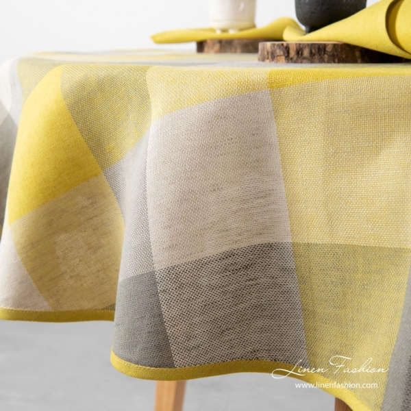 Close view of yellow grey checked oval linen tablecloth - Linen Fashion.