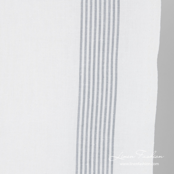 Thin grey striped edge of toweling fabric