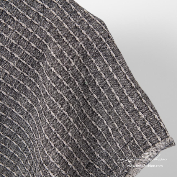 Washed black patterned linen fabric