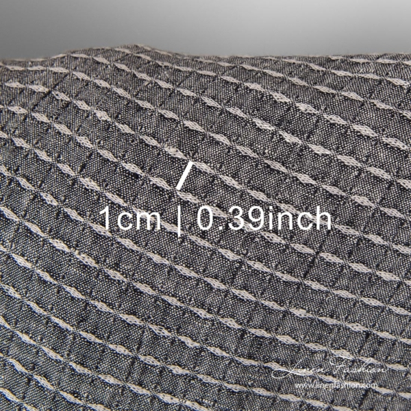 Washed black patterned linen fabric with measures