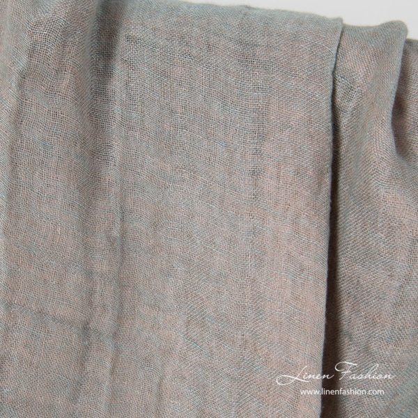 Greenish grey side of washed double layered linen fabric