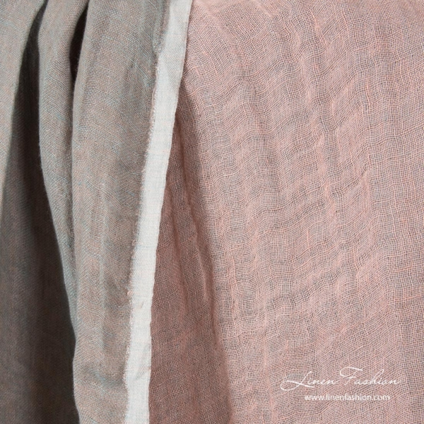Pastel pink side of washed double sided linen fabric