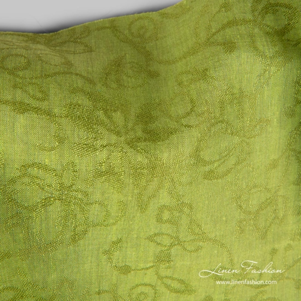 Linen fabric with woven flowers, green melange color